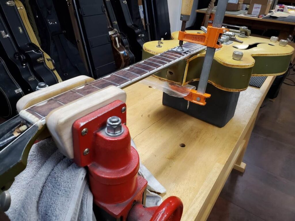 clamping Gretsch guitar